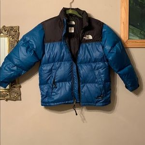 Blue and black north face puffer jacket